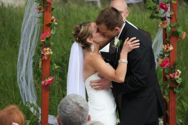 Photo of Jill and Jeff Dohner kissing during their wedding ceremony performed by Stephan J. Smith.