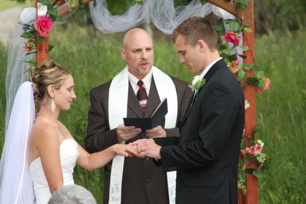 Jill and Jeff Dohner gaze lovingly at each other as they stand before Dr. Stephan J. Smith to be married..