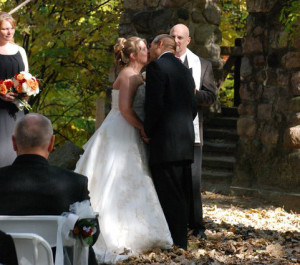 Photo of Dr. Stephan J. Smith performing wedding ceremony for Jeff and Valerie Rising.