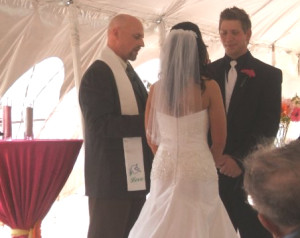 Photo of Stephan J. Smith performing the wedding of Jessica and Ryan Aulph.