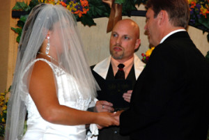 Photo of Dr. Stephan J. Smith performing the wedding of Julie and Tom Dunk.