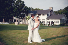 Outdoor wedding photo in front of Cromaine Lodge. Waldenwoods Resort & Conference Center.