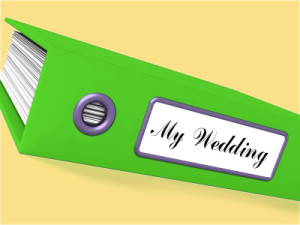 "Image of a green binder with ""My Wedding"" on the spine."